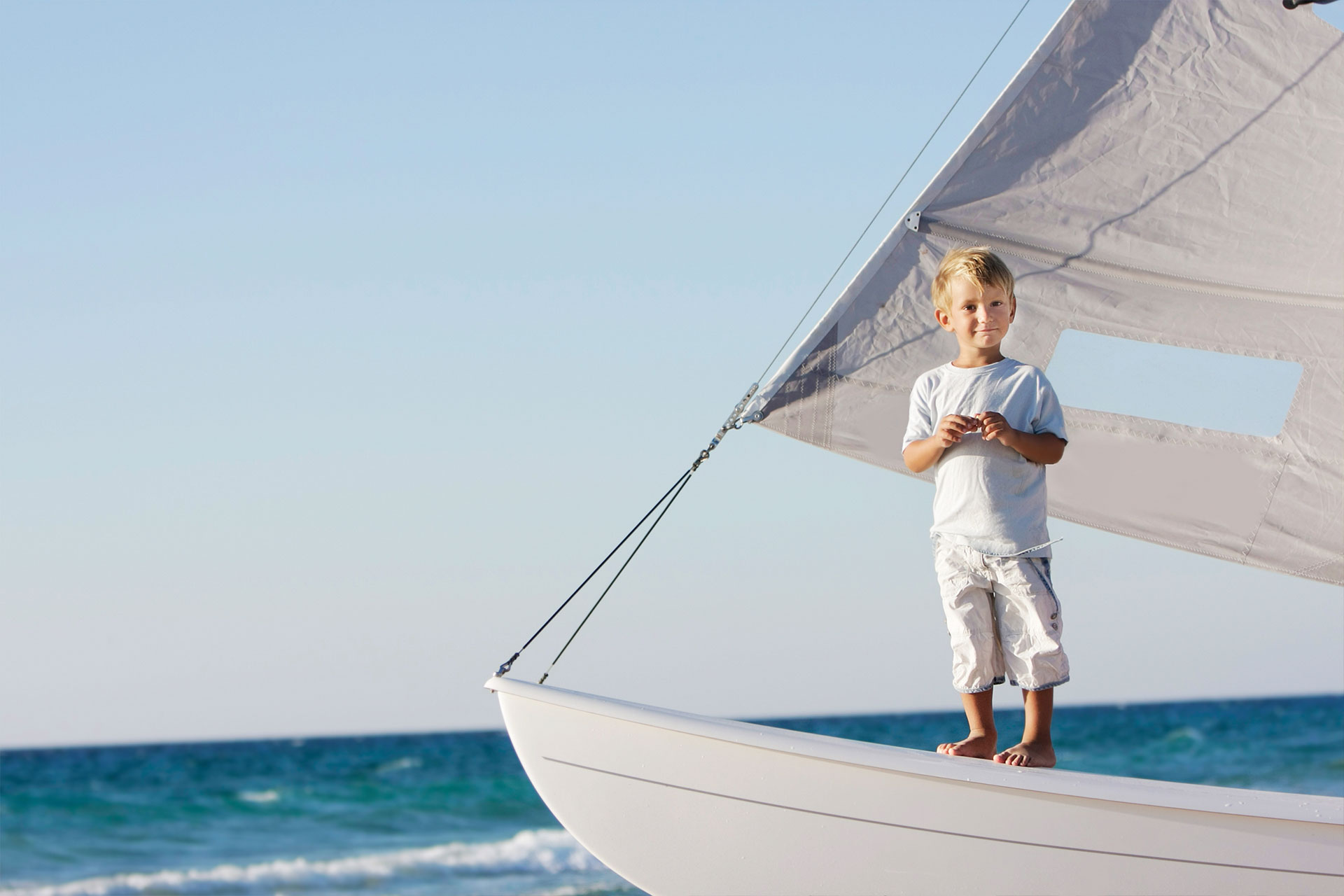 Kid on Sailboat